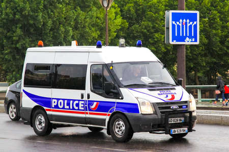 PARIS, FRANCE - AUGUST 8, 2014: Police van Ford Transit at the city street. Редакционное