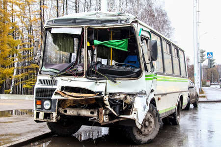 crashed: UFA, RUSSIA - NOVEMBER 4, 2011: Crashed city bus PAZ 3205 at the bus stop.