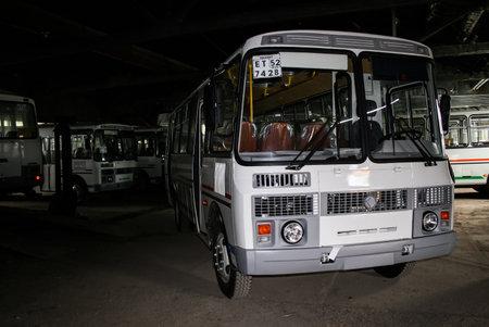hangar: ASHA, RUSSIA - JUNE 30, 2008: Brand new buses PAZ 4234 in the dark hangar.