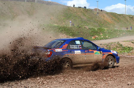 skidding: BAKAL, RUSSIA - AUGUST 8: Dmitry Tagirovs Subaru Impreza WRX No. 9 competes at the annual Rally Southern Ural on August 8, 2008 in Bakal, Satka district, Chelyabinsk region, Russia.