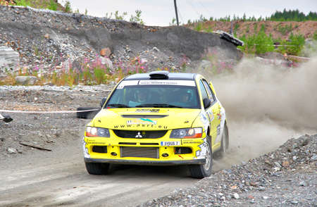 skidding: BAKAL, RUSSIA - JULY 21: Andrey Smirnovs Mitsubishi Lancer Evo IX (No. 11) competes at the annual Rally Southern Ural on July 21, 2012 in Bakal, Satka district, Chelyabinsk region, Russia. Editorial