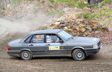 konstantin: BAKAL, RUSSIA - AUGUST 21: Konstantin Berezins Audi 80 (No. 59) competes at the annual Rally Southern Ural on August 21, 2012 in Bakal, Satka district, Chelyabinsk region, Russia. Editorial