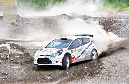 skidding: BAKAL, RUSSIA - JULY 21: Vasiliy Gryazins Ford Fiesta (No. 6) competes at the annual Rally Southern Ural on July 21, 2012 in Bakal, Satka district, Chelyabinsk region, Russia. Editorial