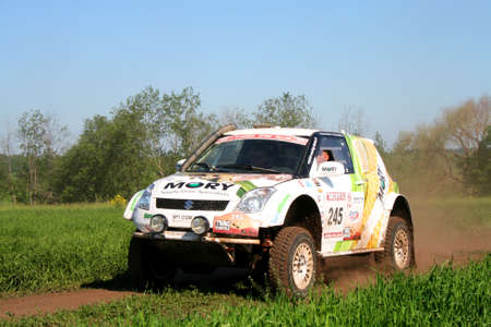 kap: TATARSTAN, RUSSIA - JUNE 15: Stephane Pinards KAP Outlaw Suzuki Swift No. 245 competes at the rally Transorientale 2008 on June 15, 2008 near town of Naberezhnye Chelny, Tatarstan, Russia.