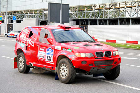 outside machines: MOSCOW, RUSSIA - JULY 7, 2012: Karol Fazekas BMW E53 X5 No. 131 takes part at the annual Silkway Rally - Dakar series. Editorial