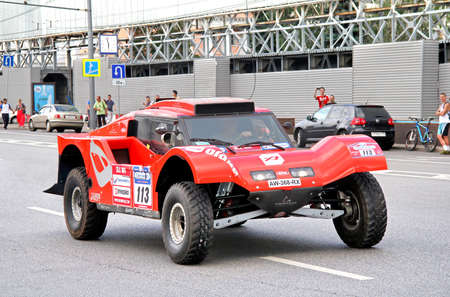 start to cross: MOSCOW, RUSSIA - JULY 7: Beniat Errandoneas SMG Buggy No. 113 of SMG Team takes part at the annual Silkway Rally - Dakar series on July 7, 2012 in Moscow, Russia.