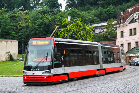 turismo ecologico: PRAGUE, CZECH REPUBLIC - JULY 21, 2014: Modern articulated tramway Skoda 15T ForCity Alfa at the city street.