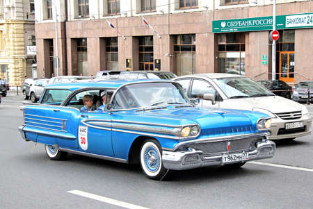 museum rally: MOSCOW, RUSSIA - JUNE 2, 2013: American motor car Oldsmobile Super 88 competes at the annual L.U.C. Chopard Classic Weekend Rally.