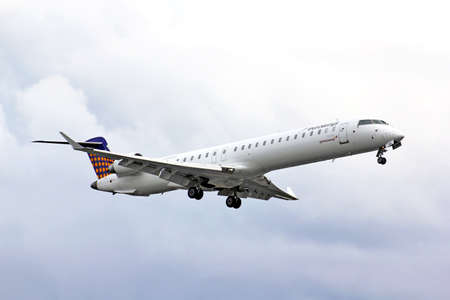 arrives: BERLIN, GERMANY - AUGUST 17, 2014: Eurowings Bombardier CRJ-900 NG arrives to the Tegel International Airport. Editorial