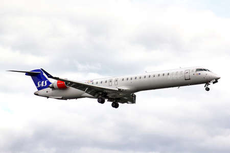 bombardier: BERLIN, GERMANY - AUGUST 17, 2014: Scandinavian Airlines Bombardier CRJ-900ER NG arrives to the Tegel International Airport.