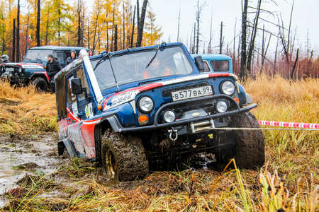 windlass: NOVYY URENGOY, RUSSIA - SEPTEMBER 19, 2015: Off-road vehicle UAZ 3151 at the autumn tundra. Editorial