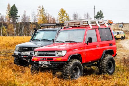 motor cars: NOVYY URENGOY, RUSSIA - SEPTEMBER 19, 2015: Motor cars Toyota Land Cruiser Prado 70 at the autumn tundra.