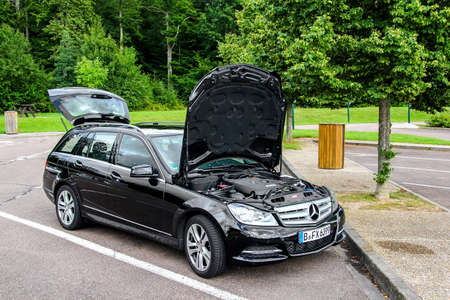 benz: RHONE-ALPES, FRANCE - AUGUST 7, 2014: Motor car Mercedes-Benz W204 C180 at the parking near the interurban freeway. Editorial