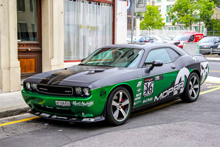 supercharged: GENEVA, SWITZERLAND - AUGUST 4, 2014: Motor car Dodge Challenger at the city street.