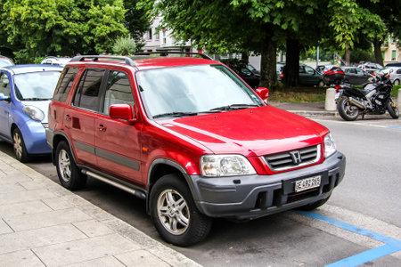 utilitarian: GENEVA, SWITZERLAND - AUGUST 4, 2014: Motor car Honda CR-V at the city street. Editorial