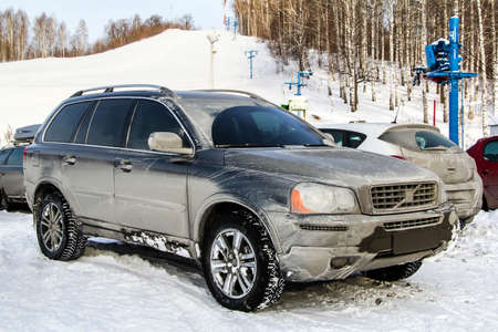crossover: ASHA, RUSSIA - DECEMBER 31, 2011: Dirty crossover Volvo XC90 at the countryside. Editorial