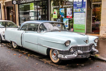PARIS, FRANCE - AUGUST 8, 2014: Motor car Cadillac Series 62 at the city street.