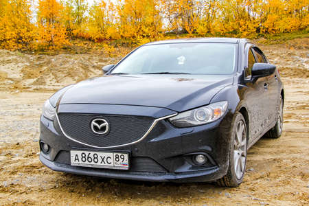 mazda: NOVYY URENGOY, RUSSIA - SEPTEMBER 13, 2014: Motor car Mazda 6 at the countryside.
