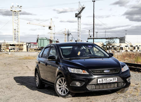 tuned: NOVYY URENGOY, RUSSIA - SEPTEMBER 5, 2015: Black motor car Ford Focus in the industrial zone. Editorial