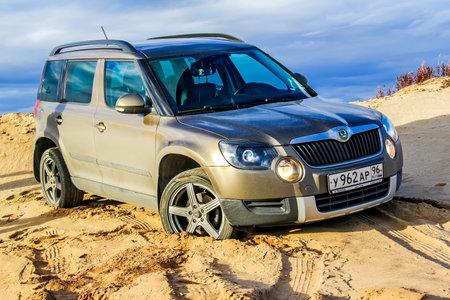 utilitarian: NOVYY URENGOY, RUSSIA - SEPTEMBER 5, 2015: Motor car Skoda Yeti at the sand desert.