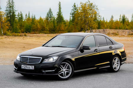 evening class: NOVYY URENGOY, RUSSIA - AUGUST 30, 2015: Motor car Mercedes-Benz W204 C-class at the countryside. Editorial