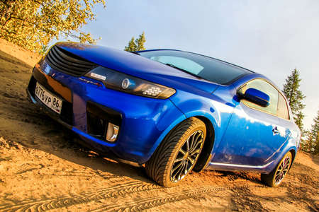 forte: NOVYY URENGOY, RUSSIA - AUGUST 30, 2015: Motor car Kia Cerato Koup at the countryside.