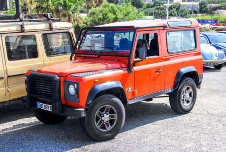 defender: RIVIERA, FRANCE - AUGUST 3, 2014: Motor car Land Rover Defender at the interurban road.
