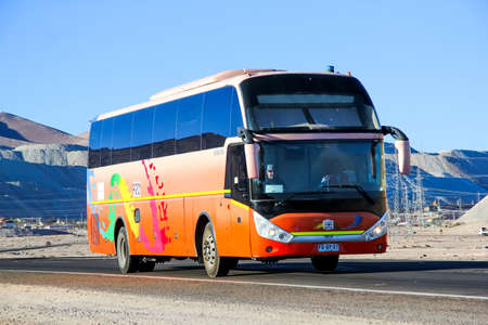 intercity: CALAMA, CHILE - NOVEMBER 17, 2015: Intercity coach bus Zhong Tong at the interurban freeway. Editorial