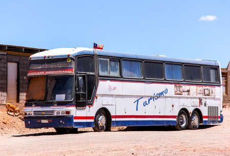 intercity: SAN PEDRO DE ATACAMA, CHILE - NOVEMBER 16, 2015: Aged intercity coach Busscar Jum Buss 380 at the countryside.