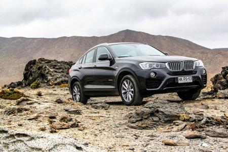 bmw: ATACAMA, CHILE - NOVEMBER 14, 2015: New black crossover BMW F26 X4 at the stone desert.