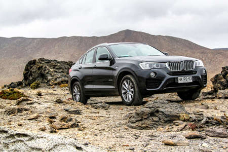 ATACAMA, CHILE - NOVEMBER 14, 2015: New black crossover BMW F26 X4 at the stone desert.