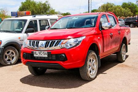 mmc: SAN PEDRO DE ATACAMA, CHILE - NOVEMBER 15, 2015: Motor car Mitsubishi L200 at the town street. Editorial