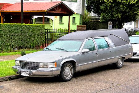 hearse: VALDIVIA, CHILE - NOVEMBER 20, 2015: Hearse car Cadillac Fleetwood at the town street. Editorial
