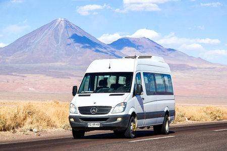 ANTOFAGASTA, CHILE - NOVEMBER 15, 2015: White minibus Mercedes-Benz Sprinter at the background of a volcano. Editorial