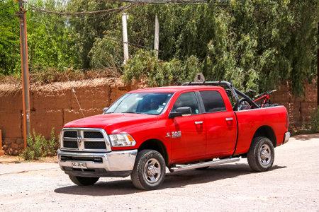 light duty: SAN PEDRO DE ATACAMA, CHILE - NOVEMBER 15, 2015: Red pickup truck Dodge Ram 2500 at the countryside.
