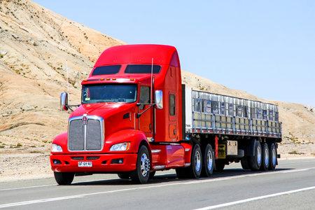 ATACAMA, CHILE - NOVEMBER 14, 2015: Red semi-trailer truck Kenworth T660 at the Pan-American Highway.