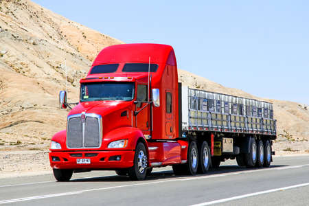 ATACAMA, CHILE - NOVEMBER 14, 2015: Red semi-trailer truck Kenworth T660 at the Pan-American Highway.