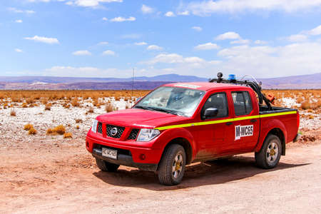 nissan: ANTOFAGASTA, CHILE - NOVEMBER 15, 2015: Red pickup truck Nissan Navara at the countryside.