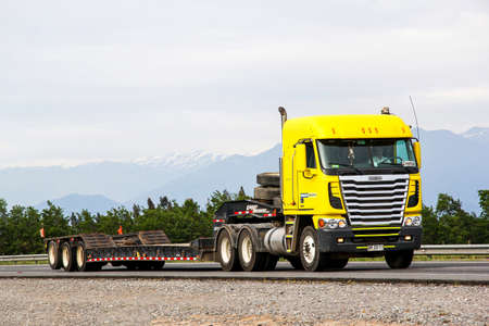 freightliner: OHIGGINS, CHILE - NOVEMBER 19, 2015: Semi-trailer truck Freightliner Argosy at the Pan-American Highway. Editorial