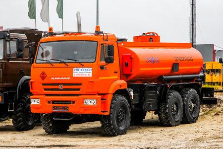 dangerous: NOVYY URENGOY, RUSSIA - SEPTEMBER 19, 2015: Brand new cistern truck KAMAZ 43118 at the city street.