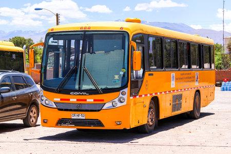 versatile: SAN PEDRO DE ATACAMA, CHILE - NOVEMBER 16, 2015: School bus Comil Versatile at the town street.