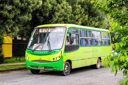 minibus: VILLARRICA, CHILE - NOVEMBER 20, 2015: Passenger minibus Busscar Micruss at the city street.