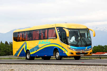 intercity: OHIGGINS, CHILE - NOVEMBER 19, 2015: Intercity coach Marcopolo Viaggio 900 at the interurban freeway. Editorial