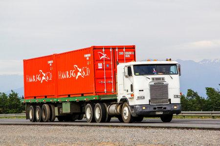 freightliner: OHIGGINS, CHILE - NOVEMBER 19, 2015: Semi-trailer truck Freightliner FLB at the Pan-American Highway. Editorial