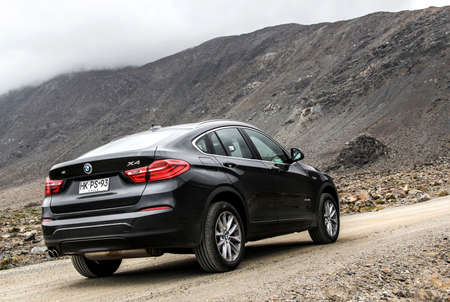 ATACAMA, CHILE - NOVEMBER 14, 2015: New black crossover BMW F26 X4 at the countryside.