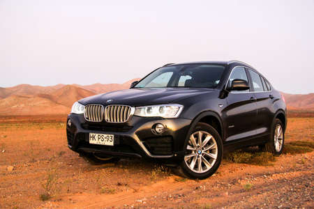 ATACAMA, CHILE - NOVEMBER 13, 2015: New black crossover BMW F26 X4 in the Atacama desert.