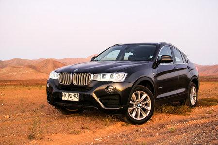 deserts: ATACAMA, CHILE - NOVEMBER 13, 2015: New black crossover BMW F26 X4 in the Atacama desert.