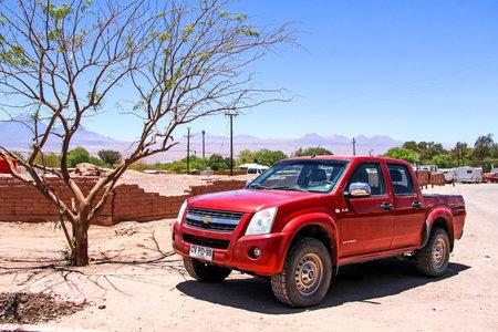 chevrolet: SAN PEDRO DE ATACAMA, CHILE - NOVEMBER 17, 2015: Red pickup truck Chevrolet LUV D-Max at the countryside.