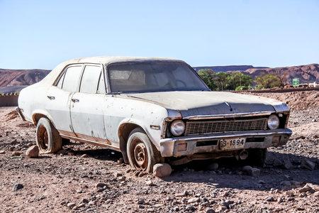 contorted: SAN PEDRO DE ATACAMA, CHILE - NOVEMBER 15, 2015: Abandoned car Chevrolet Nova in the Atacama desert.