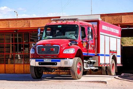 freightliner: SAN PEDRO DE ATACAMA, CHILE - NOVEMBER 15, 2015: Fire truck Freightliner Business Class at the town street.
